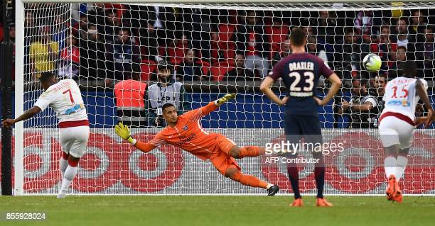 Bordeaux's Brazilian forward Malcom scores a penalty during the French L1 football match between Paris SaintGermain and Bordeaux at the Parc des...
