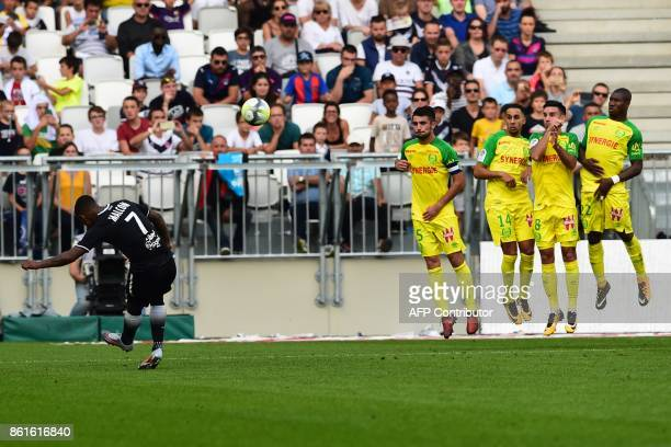 Bordeaux's Brazilian forward Malcom shoots a free kick during the French Ligue 1 football match between Bordeaux and Nantes on October 15 2017 in...