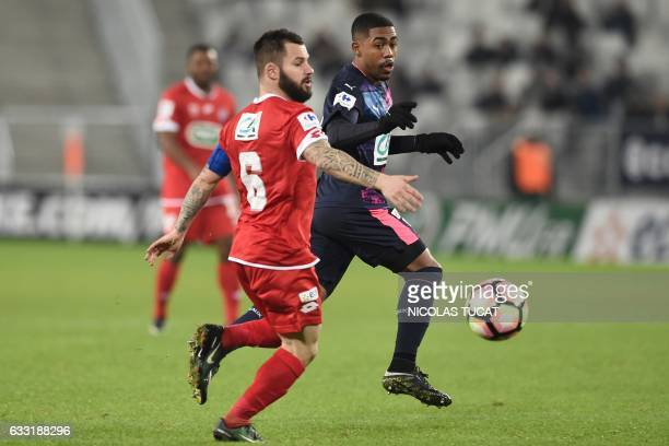 Bordeaux's Brazilian forward Malcom vies with Dijon's French midfielder Frederic Sammaritano during the French Cup football match between Bordeaux...