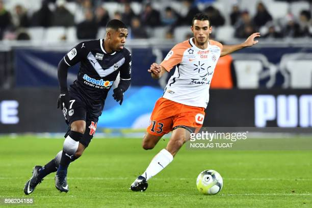 Bordeaux's Brazilian forward Malcom vies with Montpellier's French midfielder Ellyes Skhiri during the French L1 football match between Bordeaux and...