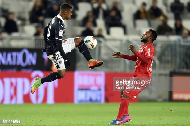 Bordeaux's Brazilian forward Malcom vies with Montpellier's midfielder Stephane Sessegnon during the French L1 football match between Bordeaux and...