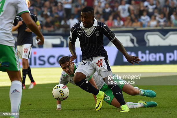 Bordeaux's Brazilian forward Malcom vies with SaintEtienne's French midfielder Benjamin Corgnet during theFrench L1 footbal match between Bordeaux...
