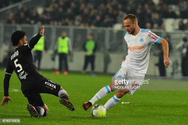 Bordeaux's Brazilian midfielder Otavio fights for the ball with Olympique de Marseille's French forward Valere Germain during the French Ligue 1...