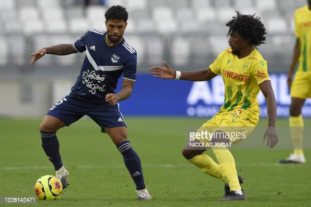 Bordeaux's Brazilian midfielder Otavio vies with Nantes' midfielder Samuel Moutoussamy during the French L1 football match between Girondins de...
