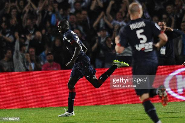 Bordeaux's Cedric Yambere celebrates after scoring a goal during the French L1 football match between Girondins de Bordeaux and Marseille on April 12...