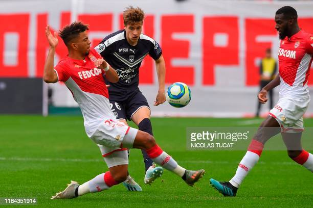 Bordeaux's Croatian midfielder Toma Basic C vies with Monaco's German midfielder Benjamin Henrichs during the French L1 football match between FC...