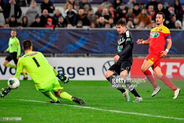 Bordeaux's Croatian midfielder Toma Basic scores a goal during the French cup football match between Bordeaux and Le Mans on January 3 at the Matmut...