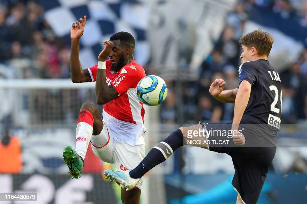 Bordeaux's Croatian midfielder Toma Basic vies with Monaco's French midfielder Tiemoue Bakayoko during the French L1 football match between FC...