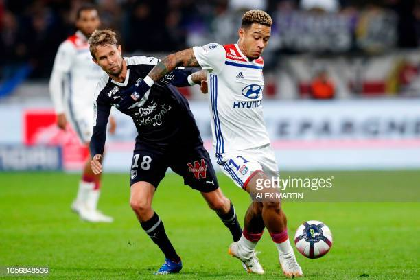 Bordeaux's Czech midfielder Jaroslav Plasil vies with Lyon's Dutch forward Memphis Depay during the French L1 football match between Olympique...