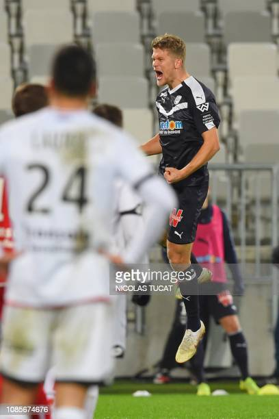 Bordeaux's Danish forward Andreas Cornelius celebrates after scoring a goal during the French L1 football match between Bordeaux and Dijon on January...