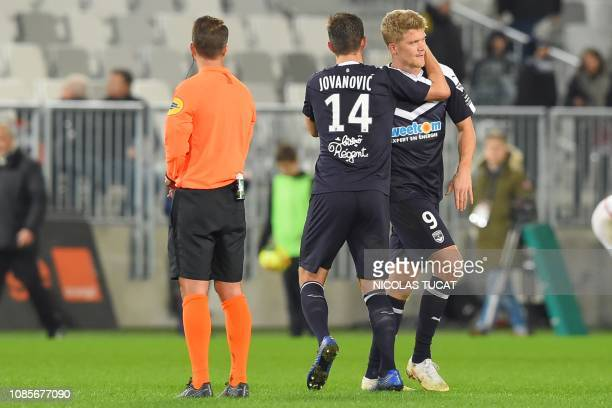 Bordeaux's Danish forward Andreas Cornelius celebrates with Bordeaux's Serbian defender Vukasin Jovanovic at the end of the French L1 football match...