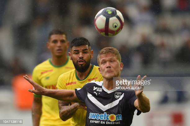 Bordeaux's Danish forward Andreas Cornelius fights for the ball with Nantes' Brazilian midfielder Lucas Lima during the French L1 football match...