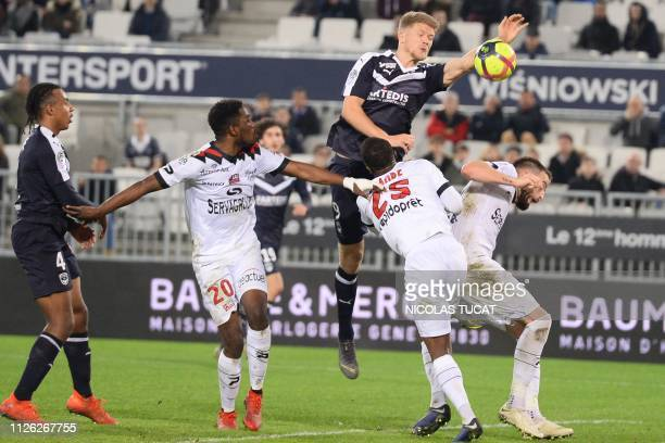 Bordeaux's Danish forward Andreas Cornelius tries to score a goal with his hand during the French L1 football match between Girondins de Bordeaux and...