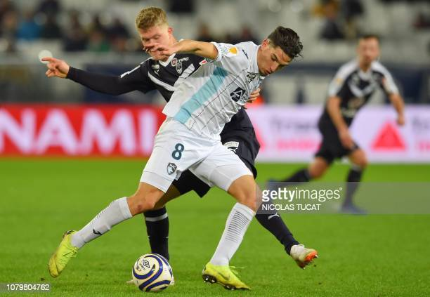 Bordeaux's Danish forward Andreas Cornelius vies with Le Havre's midfielder Zinedine Ferhat during the French League Cup quarter final football match...