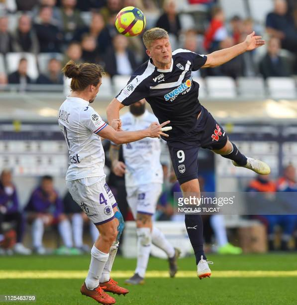 Bordeaux's Danish forward Andreas Cornelius vies with Toulouse's French midfielder Yannick Cahuzac during the French L1 football match between...