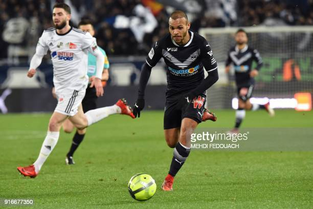 Bordeaux's Danish forward Martin Braithwaite runs with the ball during the French L1 football match between Bordeaux and Amiens at the Matmut...