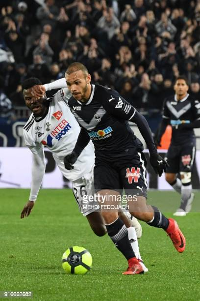 Bordeaux's Danish forward Martin Braithwaite vies for the ball with Amiens' Cameroonian midfielder Guy Ngosso during the French L1 football match...