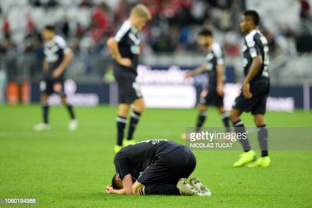 Bordeaux's Danish midfielder Lukas Lerager reacts at the end of the French Ligue 1 football match between Bordeaux and Caen on November 11, 2018 at...