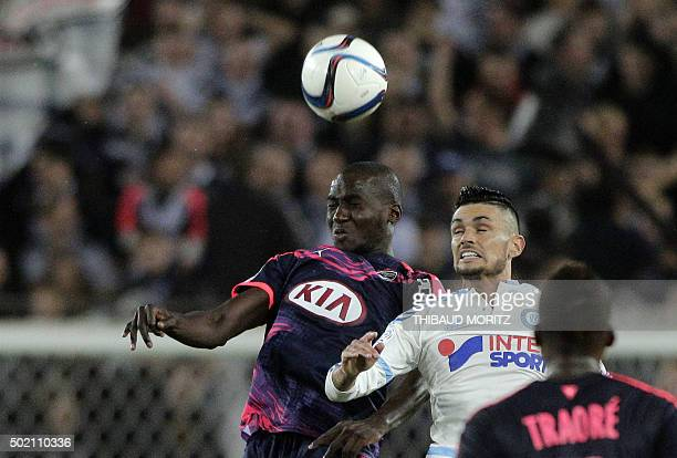 Bordeaux's defender Cedric Yambere vies with Marseille's defender Javier Manquillo during the French L1 football match between Bordeaux and Marseille...