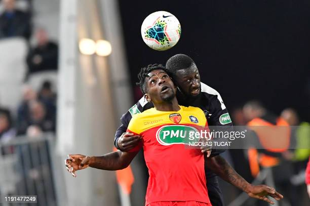 Bordeaux's defender Youssouf Sabaly vies with Le Mans' midfielder Harrison Manzala during the French cup football match between Bordeaux and Le Mans...