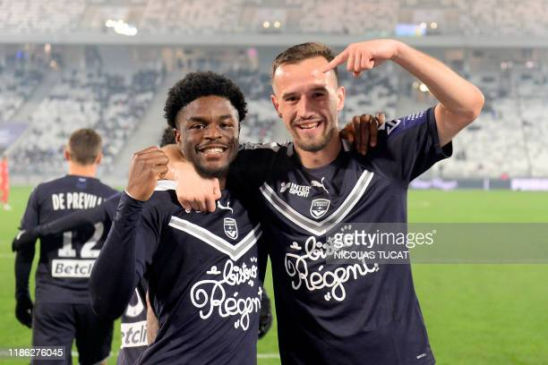 Bordeaux's English forward Josh Maja celebrates after scoring a goal with Bordeaux's Serbian defender Vukasin Jovanovic during the French L1 football...