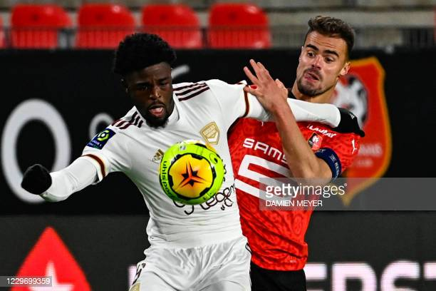 Bordeaux's English forward Josh Maja fights for the ball with Rennes' French defender Damien Da Silva during the French L1 football match between...