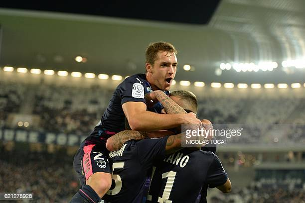 Bordeaux's Francois Kamano is congratulated by his teammate Argentinian midfielder Valentin Vada after scoring a goal during the French L1 football...