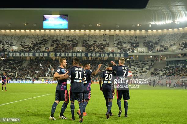 Bordeaux's Francois Kamano is congratulated by his teammates after scoring a goal during the French L1 football match between Bordeaux and Lorient on...