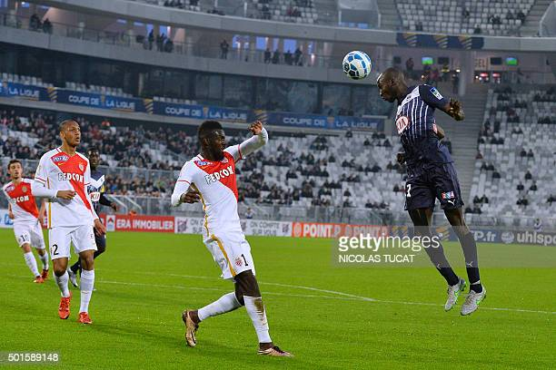 Bordeaux's French defender Cedric Yambere jumps for the ball during the French League Cup football match between Bordeaux and Monaco on December 16...