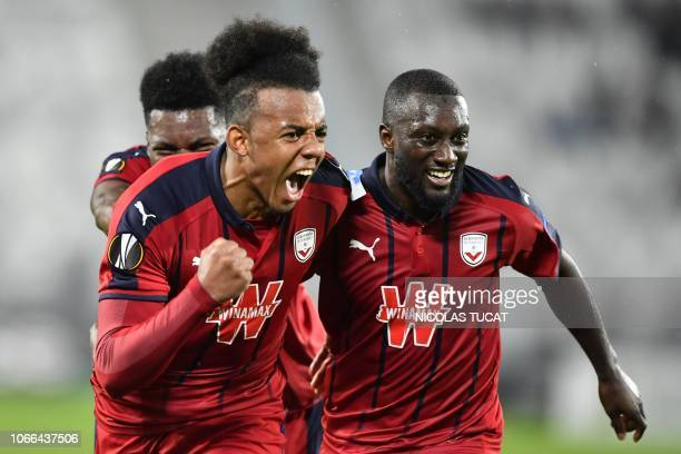 Bordeaux's French defender Jules Kounde celebrates after scoring a goal during the Europa league football match of Group C between Bordeaux and...