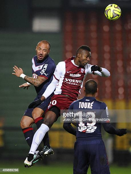 Bordeaux's French defender Julien Faubert vies for the ball with Metz' Malian forward Modibo Maiga during the French L1 football match Metz against...