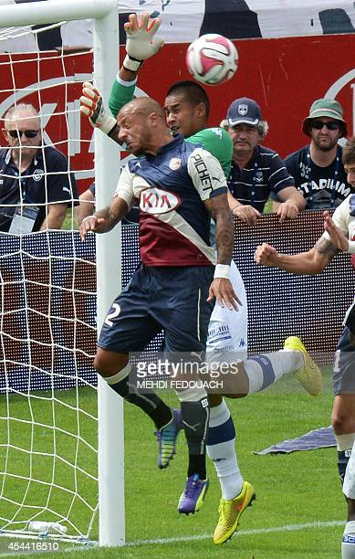 Bordeaux's French defender Julien Faubert vies with Bastia's French goalkeeper Alphonse Areola during the French L1 footbal match Bordeaux vs Bastia...