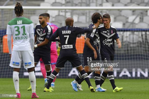 Bordeaux's French defender Laurent Koscielny leaves the pitch after being injured during the French L1 football match between FC Girondins de...