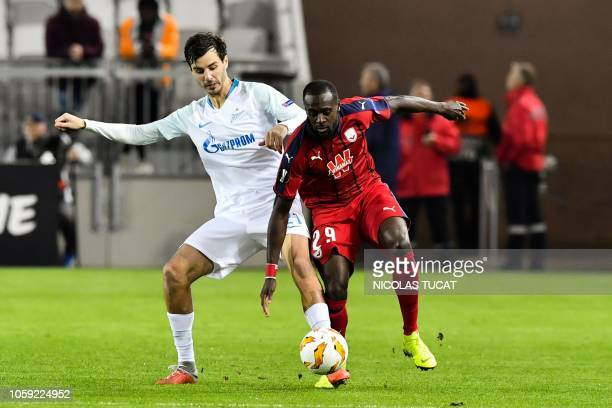 Bordeaux's French defender Maxime Poundje vies with Zenit's midfielder Aleksandr Erokhin during the Europa league football match of Group C between...