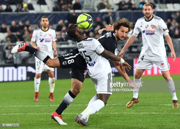 Bordeaux's French defender Paul Baysse vies for the ball with Amien's Cameroonian forward Pape Moussa Konate during the French L1 football match...