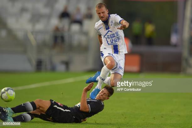 Bordeaux's French defender Theo Pellenard vies with Troyes' French midfielder Stephane Darbion during the French Ligue 1 football match between...