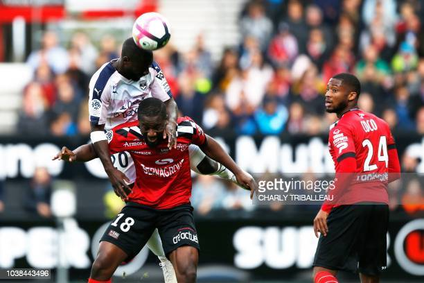 Bordeaux's French defender Youssouf Sabaly vies for the ball with Guingamp's French midfielder Guessouma Fofana during the French L1 football match...