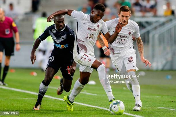 Bordeaux's French defender Youssouf Sabaly vies with Metz' French forward Opa N'Guette during the French L1 football match Bordeaux vs Metz on August...
