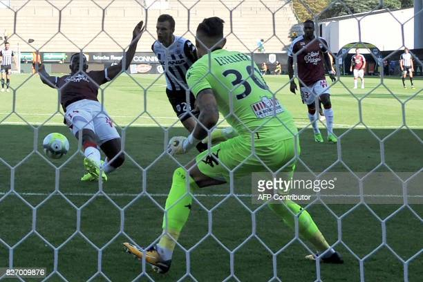 Bordeaux's French forward Alexandre Mendy scores a goal past Angers' French goalkeeper Alexandre Letellier during the French L1 football match...