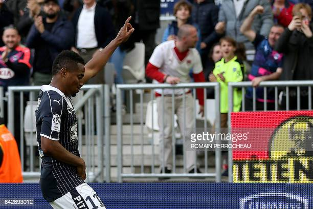 Bordeaux's French forward Francois Kamano celebrates after scoring a goal during the French L1 football match between Bordeaux and Guingamp on...