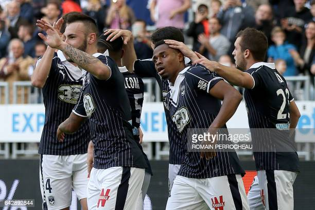 Bordeaux's French forward Francois Kamano celebrates with his teammates after scoring a goal during the French L1 football match between Bordeaux and...