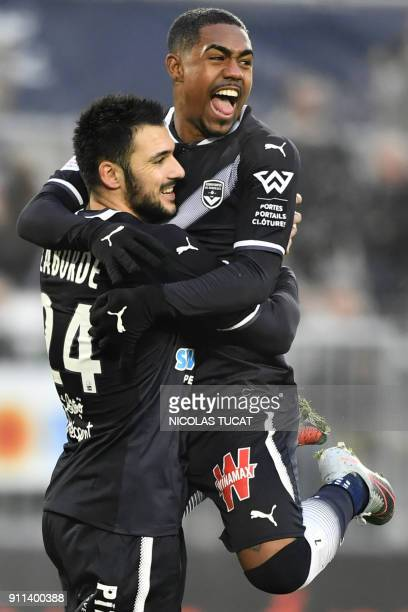 Bordeaux's French forward Gaetan Laborde celebrates after scoring a goal from a penalty with Bordeaux's Brazilian forward Malcom during the French...