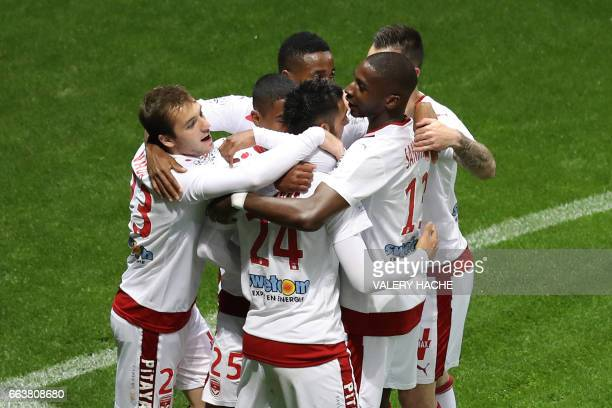 Bordeaux's French forward Gaetan Laborde is congratulated by his teammates after scoring a goal during the French L1 football match Nice vs Bordeaux...