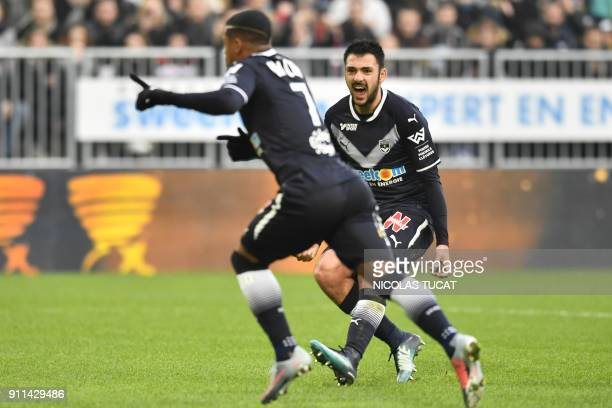 Bordeaux's French forward Gaetan Laborde reacts as Bordeaux's Brazilian forward Malcom celebrates after scoring a goal during the French L1 football...
