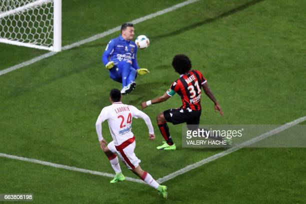 Bordeaux's French forward Gaetan Laborde scores a goal during the French L1 football match Nice vs Bordeaux on April 2 2017 at the 'Allianz Riviera'...