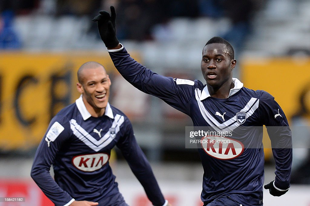 Bordeaux's French forward Henri Saivet (R) celebrates after scoring a goal next to teammate Bordeaux's French forward Yoan Gouffran , during the French L1 football match Nancy (ASNL) vs Girondins de Bordeaux, on December 16, 2012 at Marcel Picot Stadium, in Tomblaine, eastern France.