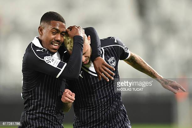 Bordeaux's French forward Jeremy Menez celebrates with his teammate Malcom after scoring during the French Ligue 1 football match between Bordeaux...