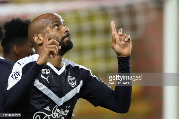 Bordeaux's French forward Jimmy Briand celebrates after scoring a penalty kicj during the French L1 football match between AS Monaco and FC Girondins...