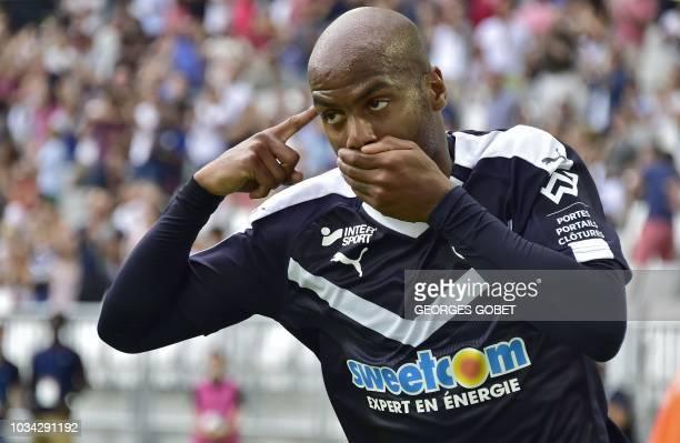 Bordeaux's French forward Jimmy Briand celebrates after scoring during the French L1 football match between FC Girondins de Bordeaux and Nimes...
