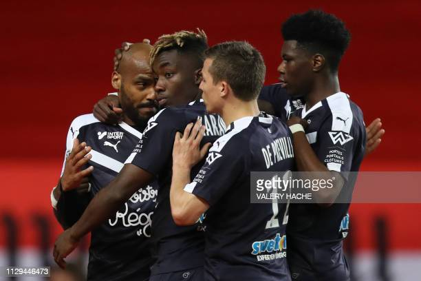 Bordeaux's French forward Jimmy Briand celebrates with teammates after scoring a penalty during the French L1 football match between AS Monaco and FC...